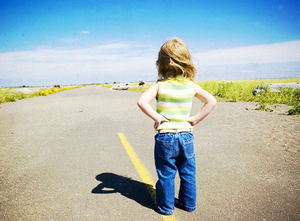 Child facing the open road